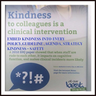 photo taken of a popup stand, with the word kindness