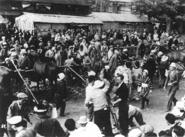 Horse (1941) during production. The guy wearing a funny white hat at the right is probabaly Akira Kurosawa.