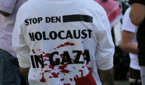 Detengan el Holocausto en Gaza: Un manifestante pro-palestina en un mitin de Berlín. Viernes, 18 de julio de 2014. (Micki Weinberg / The Times of Israel)