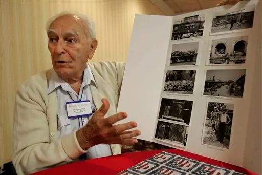 Frank W. Towers, of Gainsville, Fld. president of the 30th Infantry Division Veterans of WWII talks about the liberation of Holocaust survivors from concentration camps as he shows his photos taken at Buchenwald in late May 1945 Friday, March 27, 2009, in Charleston, S.C. (AP Photo/Mary Ann Chastain)