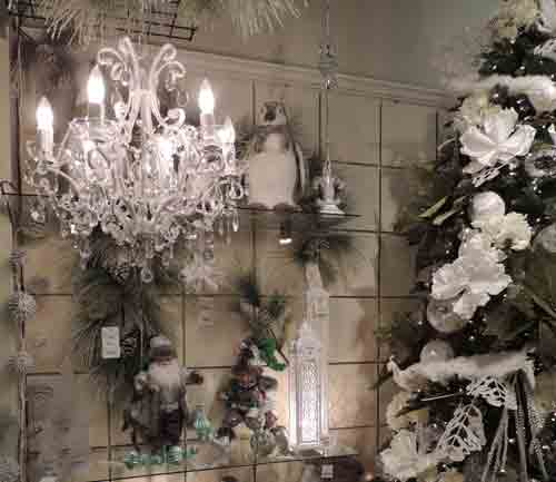 Petite, white, faux crystal chandeliers make for dazzling focal points in a display featuring snowy whites and icy-silver decorations in the Renaissance showroom.