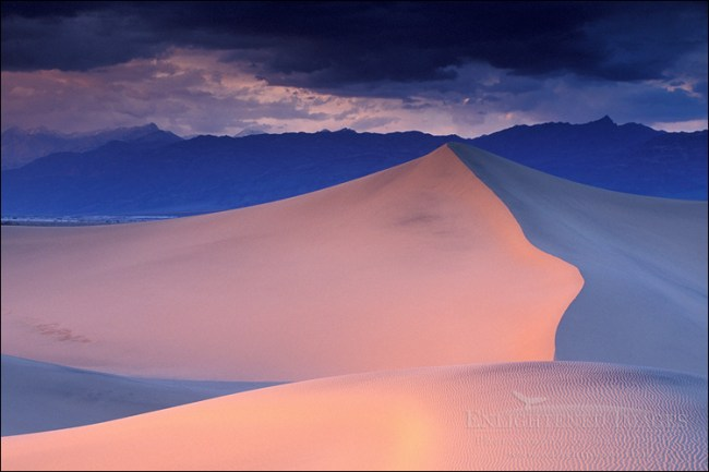 Image: Storm clouds in evening over sand dunes and mountains, Stovepipe Wells, Death Valley National Park, California