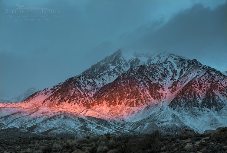 Image: Alpenglow at sunrise through storm clouds on Mount Tom, Inyo County, Eastern Sierra, California