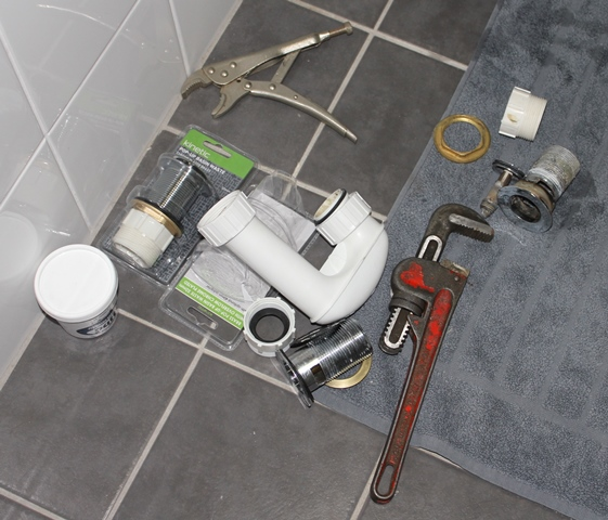 Tools for fixing the bathroom sink.