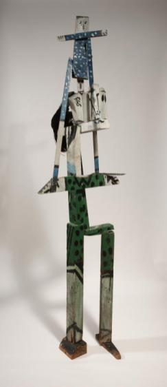 Pablo Picasso, Femme portant un enfant, 1953 Morceau de feuille de palmier et bois, peints en vert, bleu, noir et blanc 173 x 54 x 35 cm Collection particulière / Photo © Maurice Aeschimann © Succession Picasso 2016