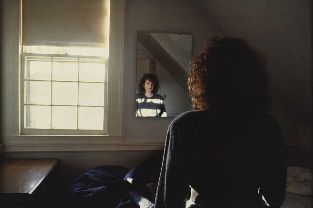 Nan Goldin - Self portrait in the Mirror, The Lodge, Belmont, 1988
