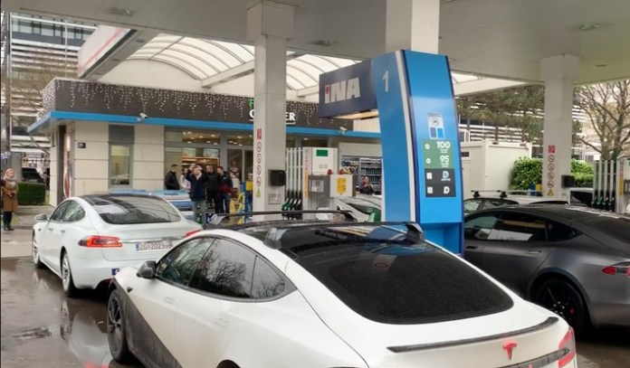 Electric car owners parked at gas stations to get revenge!