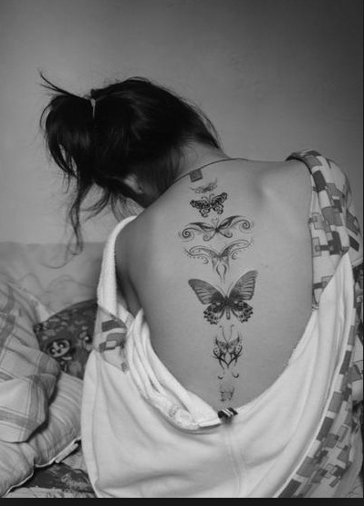 girl butterfly tattoo back
