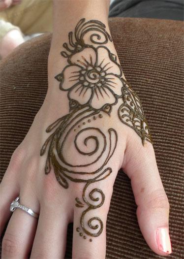 henna flower on hands