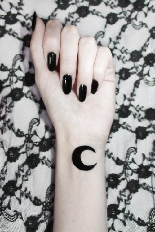 small moon tattoo on wrist
