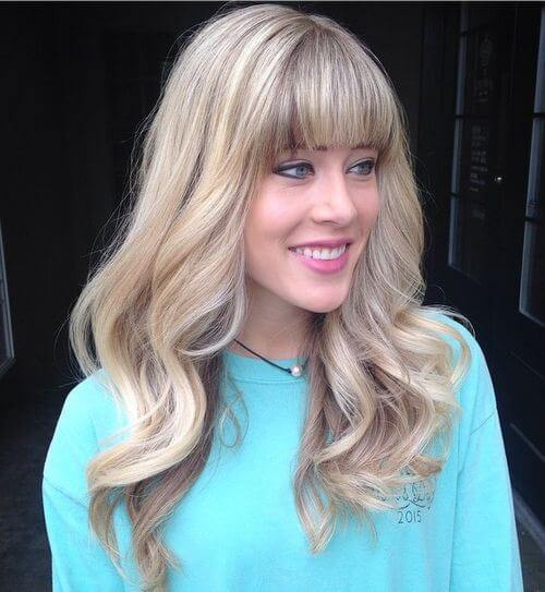 wavy textured strands with bangs