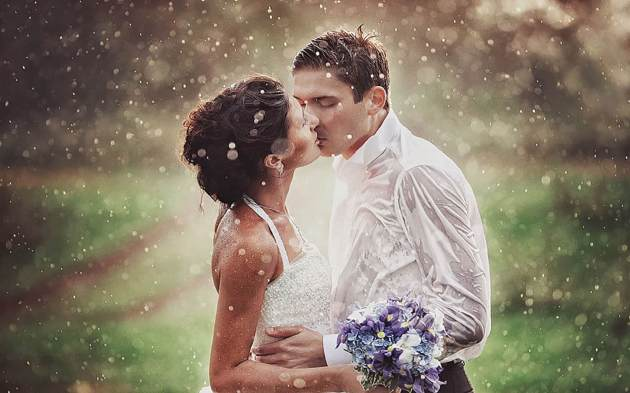 wedding kiss in rain