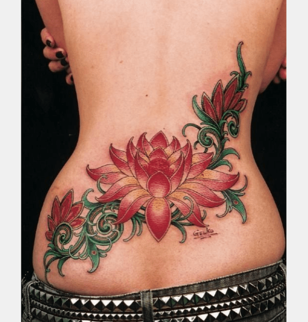 Cool lotus branch tattoo on lower back