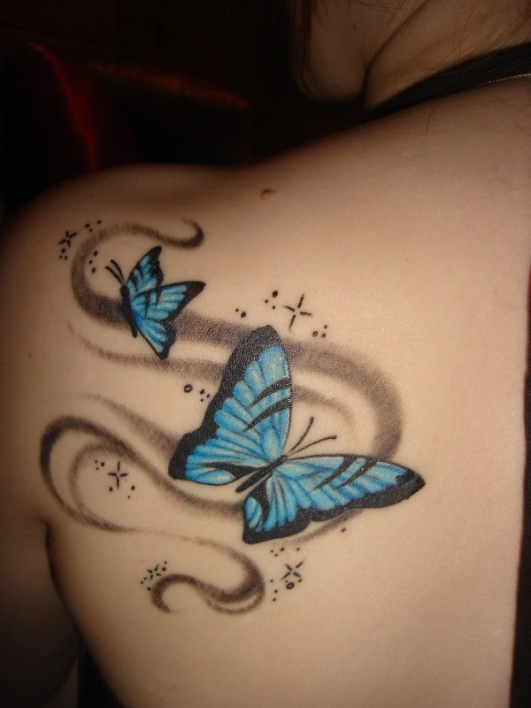 Cute and cool small blue butterflies tattoo