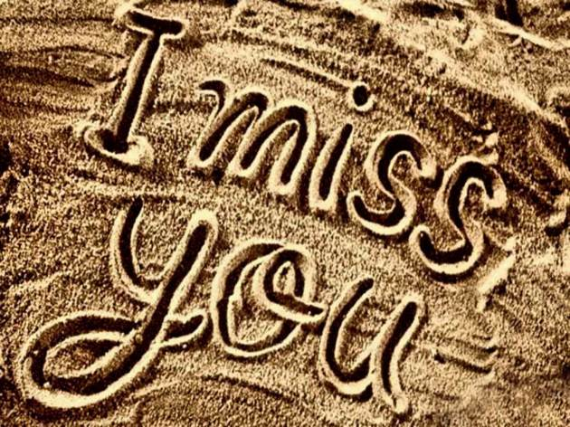i miss you lettering on beach sand