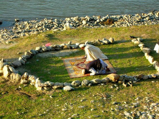 namaz prayer at river bank Mingora Pakistan