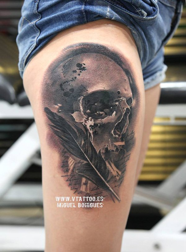 skull with feather thigh tattoo