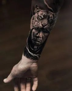 Black and grey native American warrior tattoo on forearm