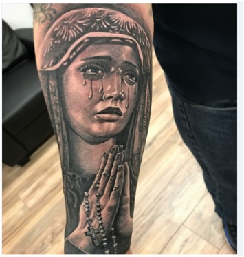 Prayers of the crying Holy Rosary tattoo on forearm
