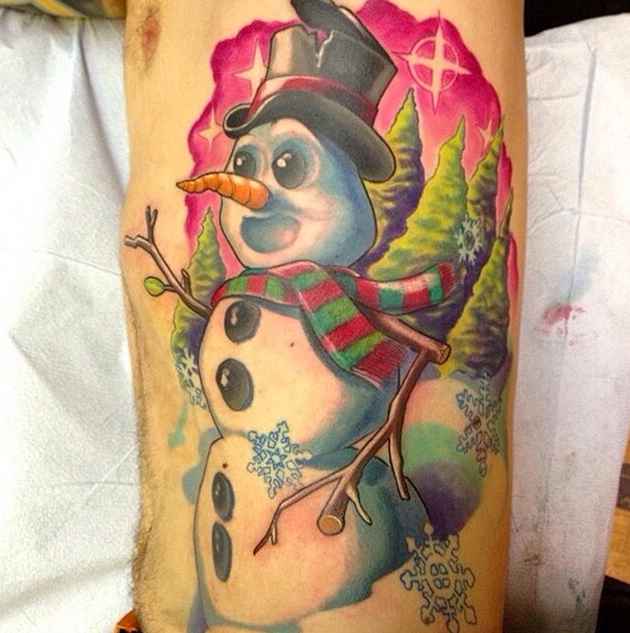 big colorful snowman rig cage tattoo for christmas