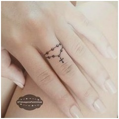 finger ring rosary tattoo