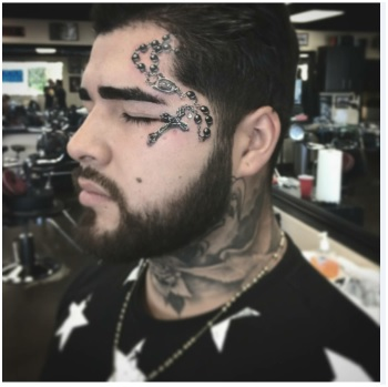 rosary tattoo on face