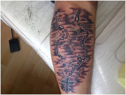 rosary tattoo on leg