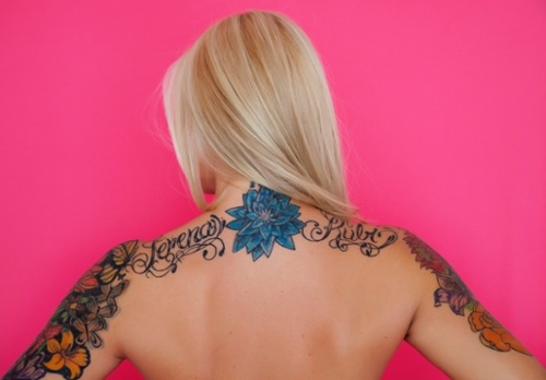 Beautiful Aster Flower tattoo on back