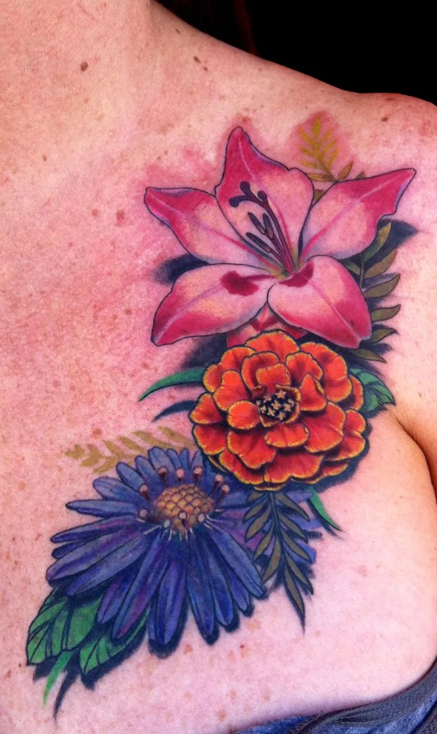 colorful flowers tattoo aster, gladiolus,marigold on chest
