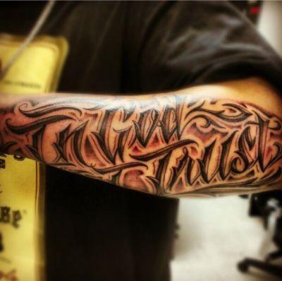 artistic in god we trust tattoo design