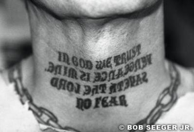 in god we trust neck tattoo