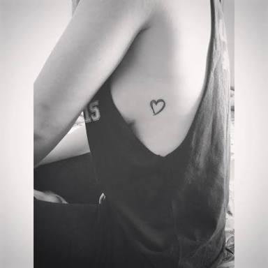 cute rib cage heart tattoo for girls