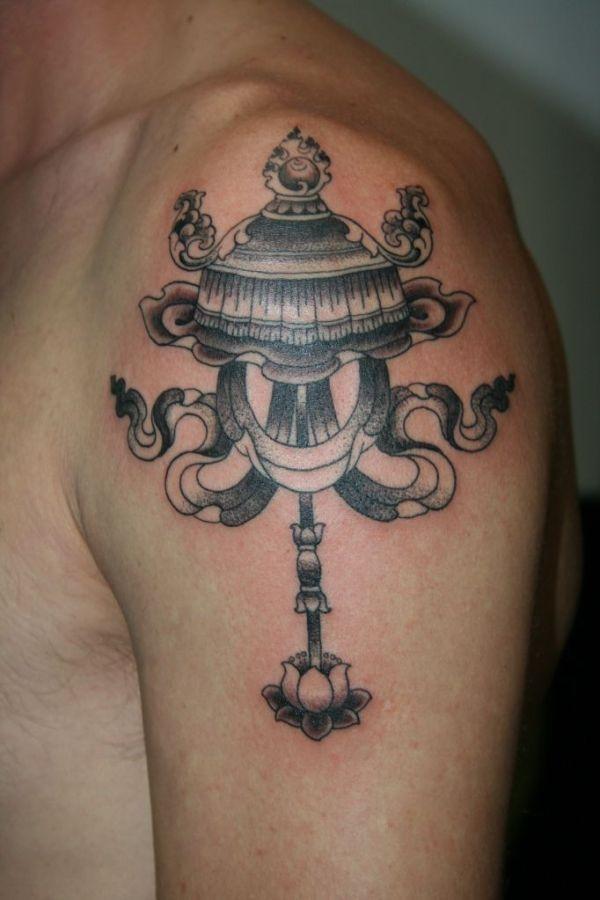 parasol Buddhist symbol tattoo on upper sleeve for men