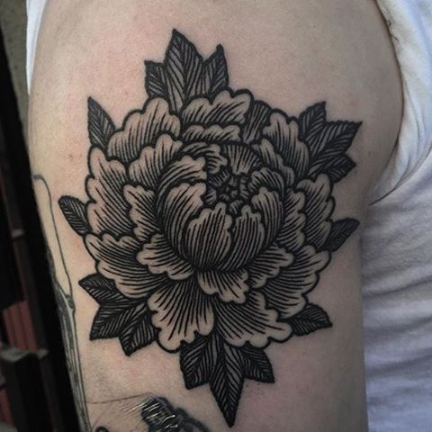 traditional peony flower tattoo on shoulder for men