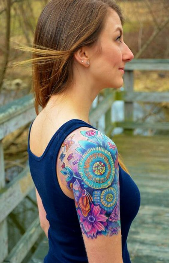 colorful flowers and butterflies tattoo for female quarter sleeve