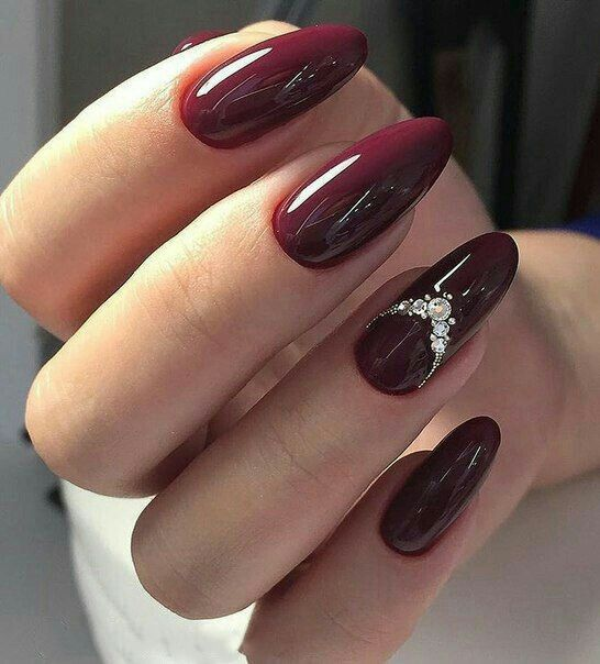 burgundy nails with pearls on single finger