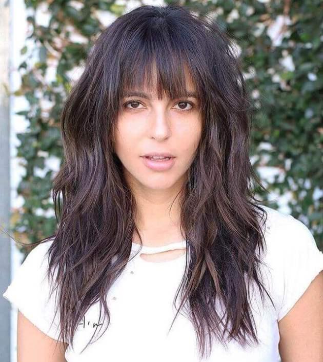 medium layered bangs hairstyle