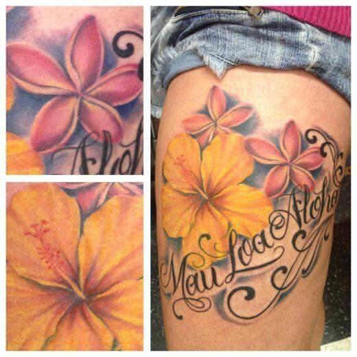 polynesian hibiscus-plumeria flowers tattoo on thigh