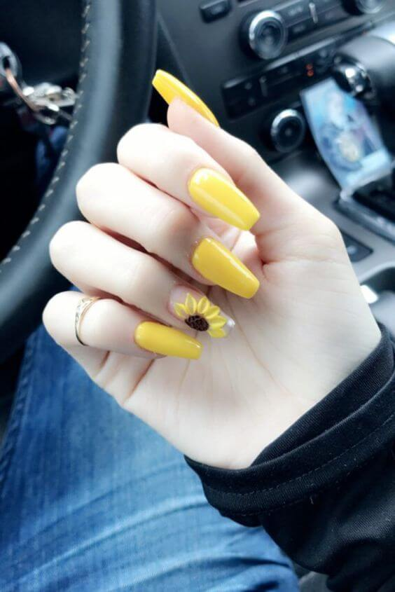 yellow acrylic coffin nails with sunflower design on one finger