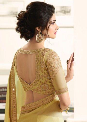 golden colour bridal blouse back design with saree
