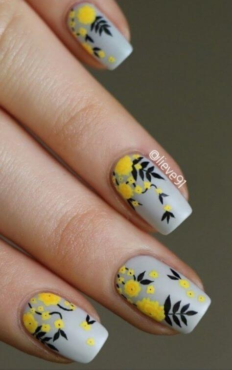 grey nails with yellow flowers