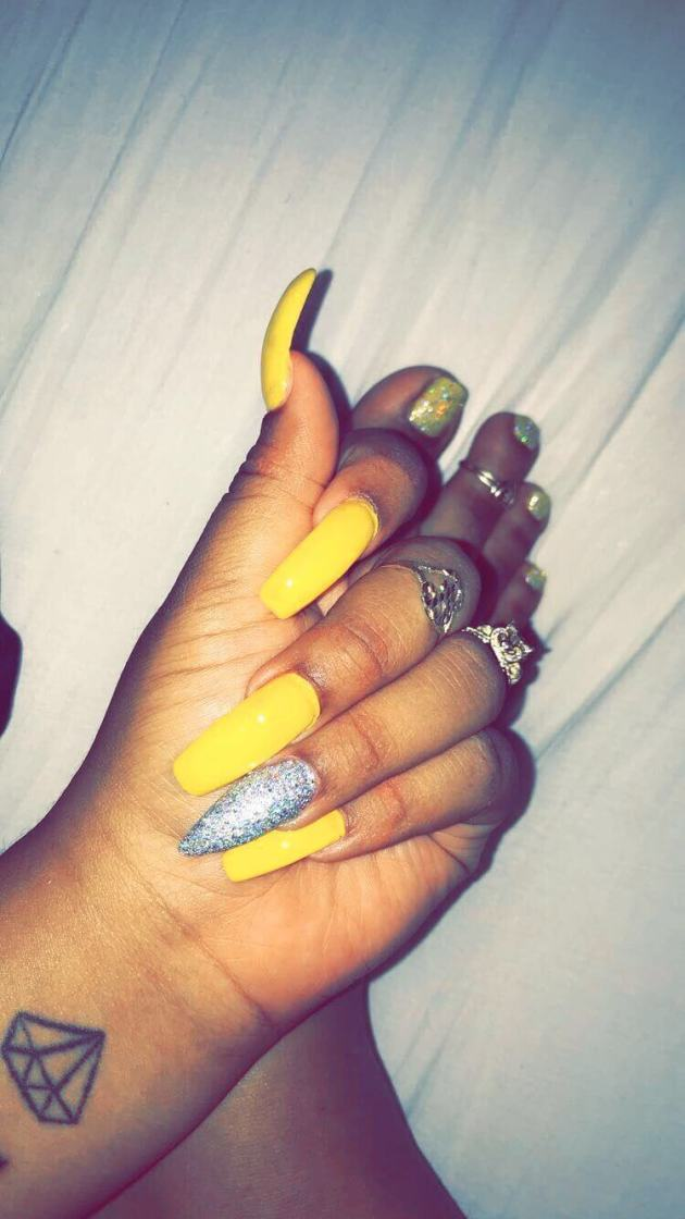yellow acrylic coffin nails with silver glitter designs