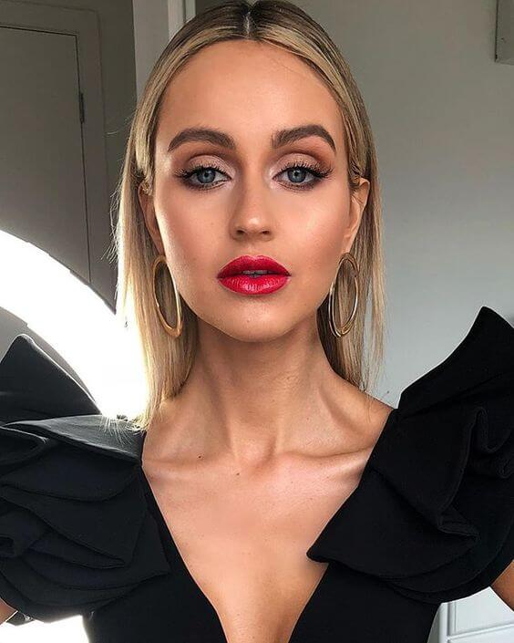 blond girl makeup with red lipstick for black dress