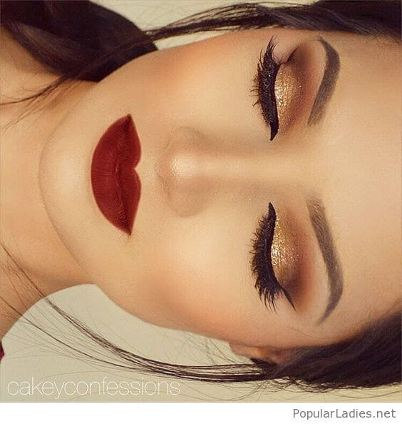 golden eye makeup with red lips for black dress