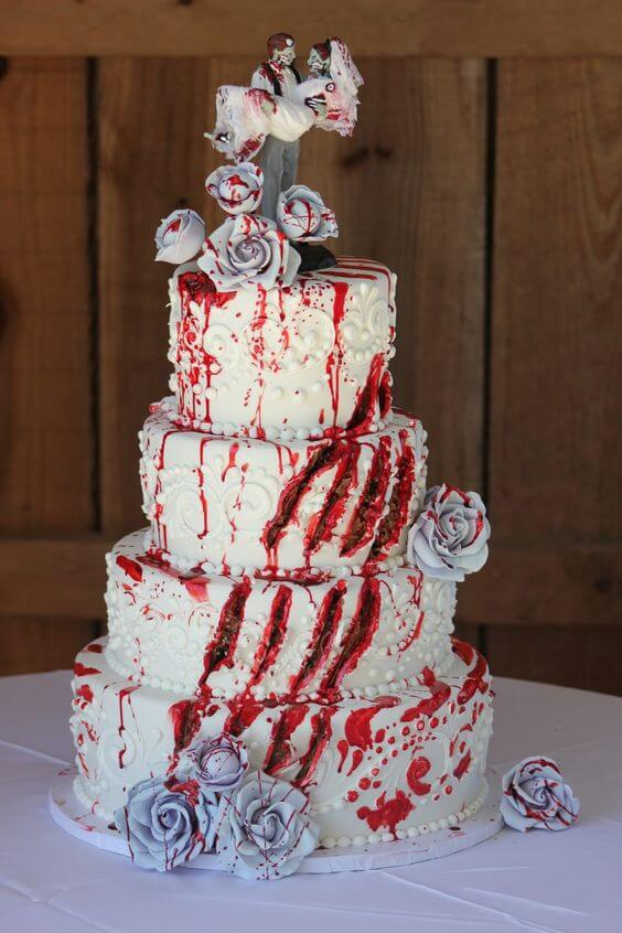 white halloween wedding cake slashed with red claws