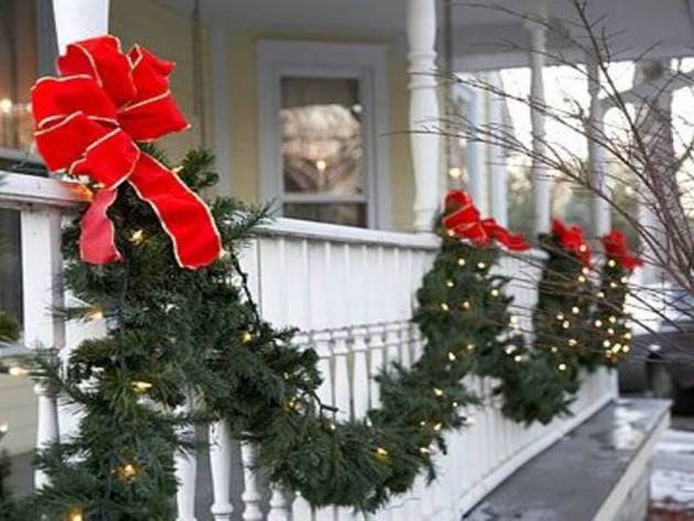 outdoor christmas balcony decoration in green and red