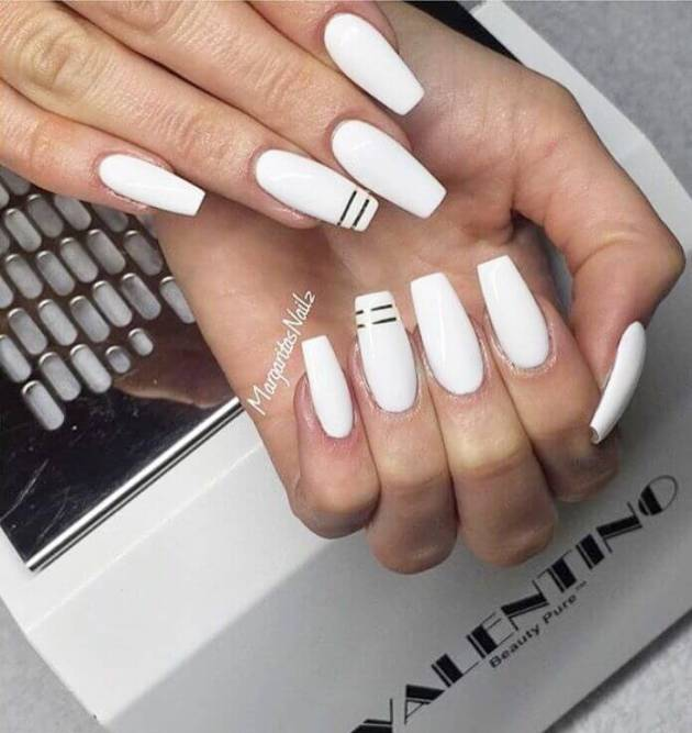 white acrylic coffin nails with golden lines