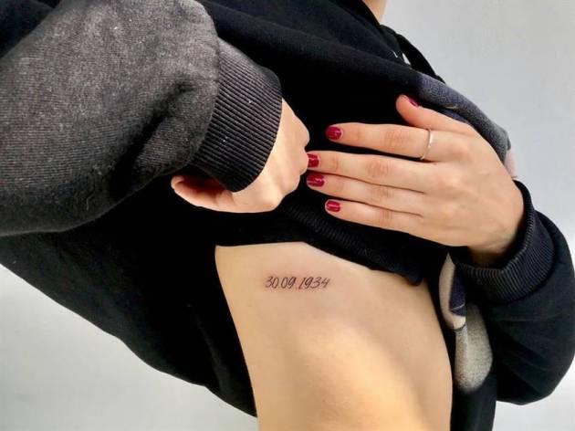 birthdate tattoo on upper stomach for females