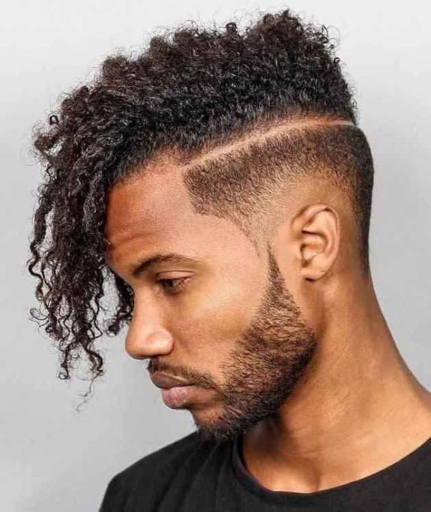 low skin fade parted curly haircut for black men