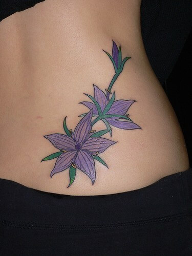 purple jasmine floral tattoo designs on lower back